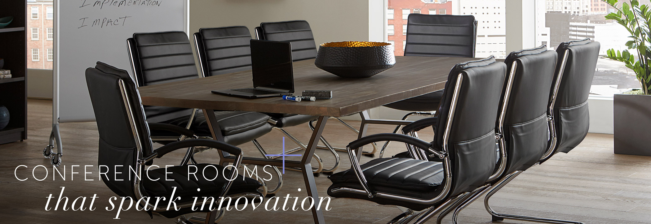 Rented conference table with words 'conference room that sparks innovation'