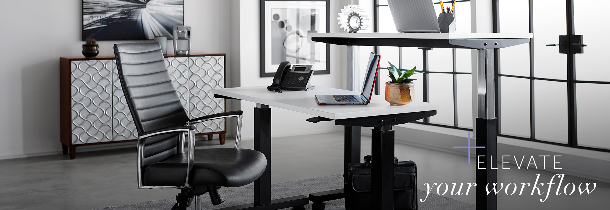 Office with rented standing desks with words 'elevate your workflow""