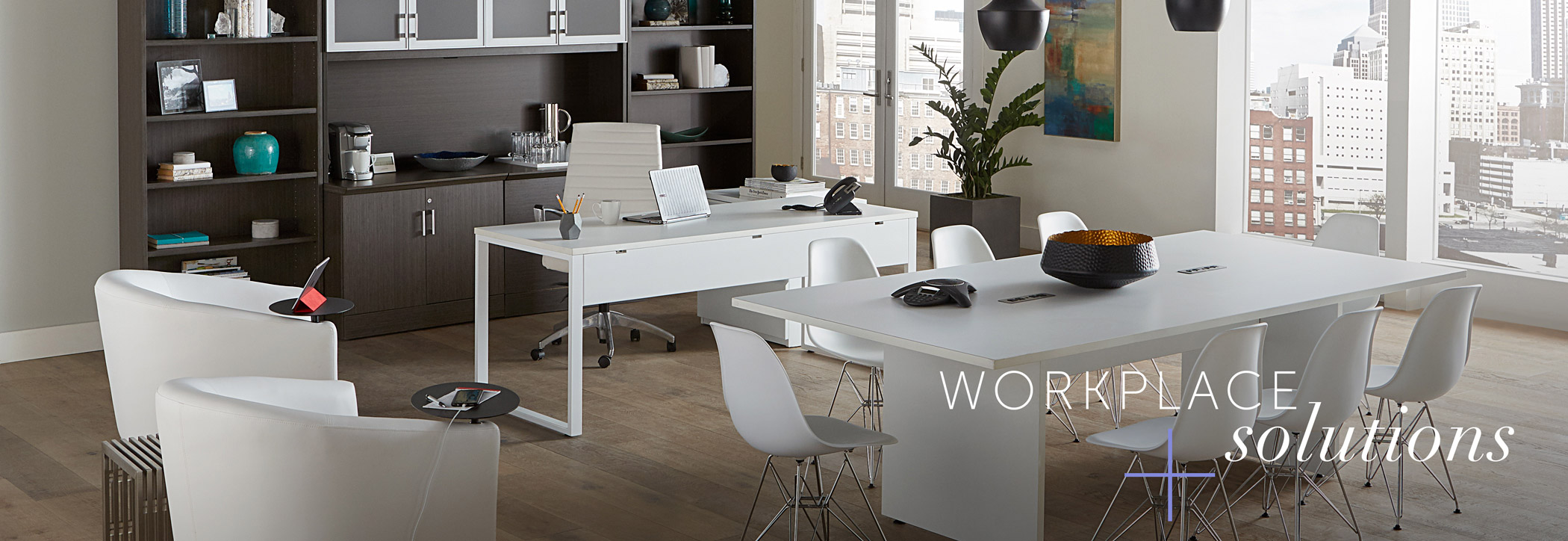 Rented furniture from AFR in office space with words 'workplace solutions'